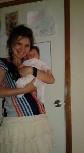 mother holding baby while being depressed