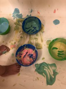 Toddler painted with edible bathtub paint