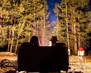 Couple sitting by a bonfire