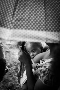breastfeeding mother with baby