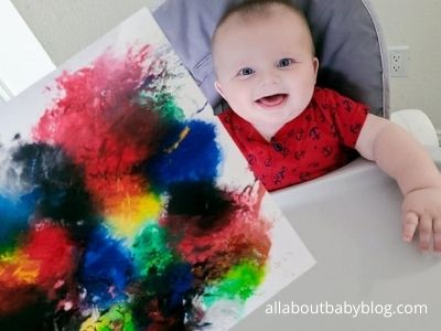 Excited baby with finished no mess painting